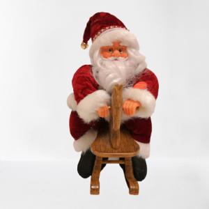 Figura Papa Noel sobre caballito balancín con música y movimiento