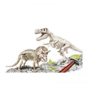 Arqueojugando de clementoni, T-Rex y triceratops dos en uno, brillan en la oscuridad